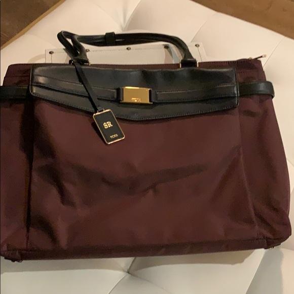 Tumi Handbags - Tumi travel briefcase in garnet and black leather